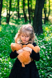 Girl with teddy-bear toy Royalty Free Stock Images