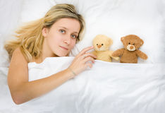 Girl and teddy bears Stock Image