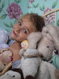 Girl with teddy bears. Little girl with her teddy bears on her bedroom Stock Images