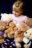 Girl with teddy bears Royalty Free Stock Photos
