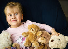 Girl with teddy bears. Portrait of a cute little girl with her collection of teddy bears Stock Photo