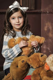 Girl with teddy bears Royalty Free Stock Images