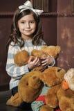 Girl with teddy bears Royalty Free Stock Photo