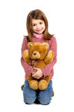 Girl and teddy Stock Image