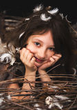 Girl teen in bird's nest Royalty Free Stock Image