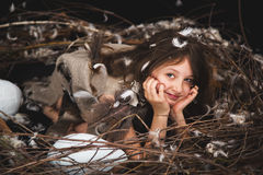Girl teen in bird's nest Stock Image