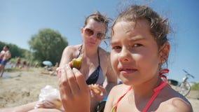 Girl teen eats sandwich on beach holiday vacation sea water slow motion video. Girl eats teen sandwich on beach holiday vacation sea water slow motion video stock footage