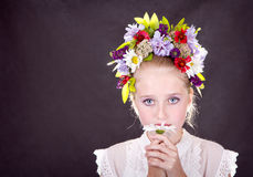 Girl or teen with flowers in hair. Girl or teen with many flowers in hair on grey background Royalty Free Stock Image