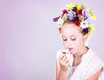 Girl or teen with flowers in hair Stock Photos