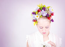 Girl or teen with flowers in hair Stock Photo