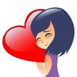 Girl teen hugs heart pillow Stock Image