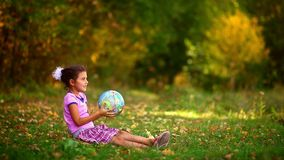 Girl  teen sitting green grass playing studying stock footage