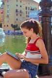 Girl teen with skateboard and tablet selfie royalty free stock image