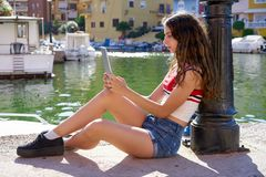 Girl teen with skateboard and tablet selfie stock photo