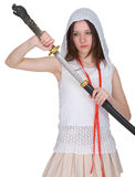 Girl teen slowly takes out katana from sheath Stock Photos