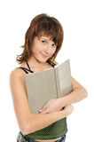 Girl the teenager with the book smiles Stock Images