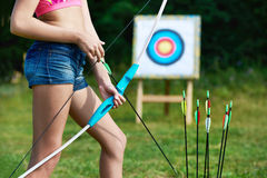 Girl teenager with bow and arrows on background of target Royalty Free Stock Image