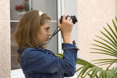 Girl-teenager with the camera Royalty Free Stock Photo