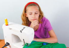 Girl teenager comes up with a new model of clothes Stock Image