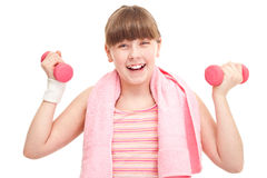 Girl teenager with dumbbells Stock Photo