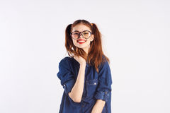 Girl teenager with glasses on white  background, smile Royalty Free Stock Photo