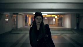 Girl teenager goes at night in the underpass.  stock video footage