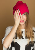 The girl teenager in the hat  covers his eyes Royalty Free Stock Photography