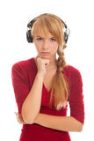 Girl teenager in headphones looks to camera Royalty Free Stock Photos