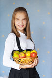 Girl-teenager holding basket Stock Photos
