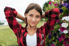 Free Girl Teenager In A Red Shirt, In The Summer In The Park Straightens Hair, Outdoor Recreation, Close-up Portrait. Royalty Free Stock Images - 137879279