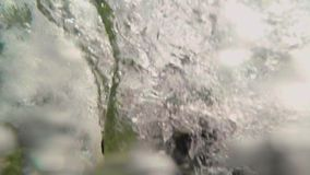 Girl teenager jumps from a cliff into the water rises a lot of bubbles, shooting under water.girl teenager jumping from. Teenage Girl Uses Gopro Stick In Ocean stock footage