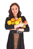 Girl-teenager keeps in hands a fruit Stock Image