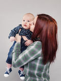 The girl the teenager kisses the baby Stock Images