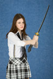 Girl - teenager menacingly brandishes a sword Stock Photo