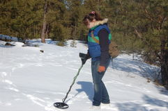 Girl teenager with metal detector in the forest Stock Photo
