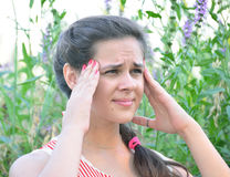 Girl teenager with migraine on nature Stock Photo