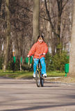 Girl-teenager on park on a bicycle (1) Royalty Free Stock Photos
