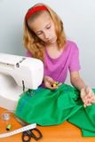 Girl teenager picks up a suitable color thread Royalty Free Stock Photos