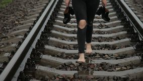 Teen girl walking barefoot on a train stock footage