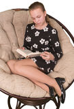 Girl teenager reading dook Royalty Free Stock Photos