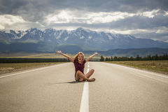 Girl teenager and the road to mountains Stock Image