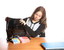 The girl-teenager shakes out textbooks from  bag Stock Photo