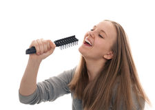 She sings always!. Girl teenager sings, using a hairbrush for hair instead of a microphone Stock Images