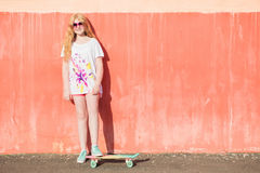 Girl teenager with skateboard Royalty Free Stock Photo