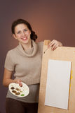 Girl teenager standing near easel Stock Photography