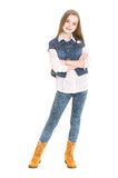 Girl teenager standing. On a white background Royalty Free Stock Photo