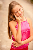 Girl-teenager on summer vacations. Schoolgirl in red vest wriggles and jokes during summer vacations Royalty Free Stock Photos