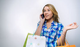 Girl teenager talking by smartphone and holding Royalty Free Stock Photo