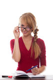 Girl teenager with textbook and pen in glasses Stock Image