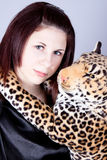 Girl the teenager with a toy a panther Royalty Free Stock Images